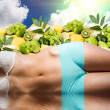 Woman body in water over fresh fruits and sunny sky — Stock Photo #3927769