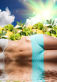 Woman body in water over fresh fruits and sunny sky — Stock Photo