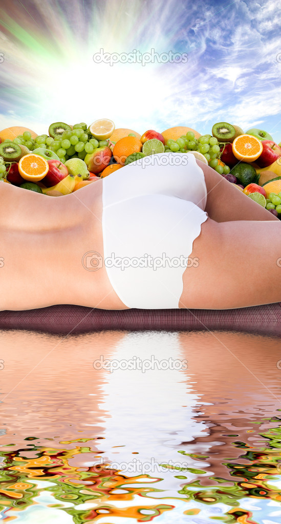 Woman body in water over fresh fruits and sunny sky — Stock Photo #3927774