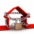 Home locked in chains on white background — Stock Photo
