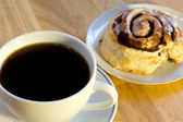 Coffee and cinnamon roll — Stock Photo