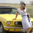 Girl and classic car - Stock Photo