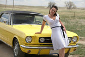 Girl and classic car — Stock Photo