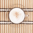 Cappuccino cup on bamboo mat - Stock Photo