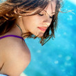 Portrait of the young beautiful brunette in the sea - Photo
