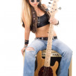 Woman with a guitar. Rock-n-roll style — Stock Photo