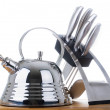 Series of images of kitchen ware. Teapot and knife — Stock Photo