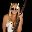 Sexual blonde and a white bass guitar — Stock Photo