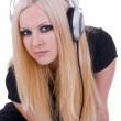 Beautiful blonde with a headphone — Stock fotografie