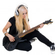 Beautiful blonde with a guitar - Stock Photo
