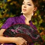 Japanese Girl in a Kimono — Stock Photo #3996811