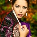 Japanese Girl in a Kimono — Stock Photo #3996824