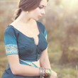Young beautiful brunette in the indian national dress — Stock Photo