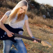 Stock Photo: Beautiful blonde with a guitar