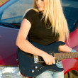 Beautiful blonde with a guitar — Stock Photo