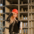 Young girl in a helmet before building - Stock Photo
