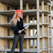 Young girl in a helmet before building — Stock Photo