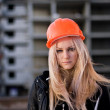 Young girl in a helmet before building - Stockfoto