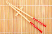 Japanese chop sticks on bamboo — Stock Photo