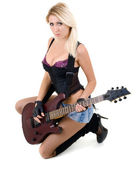 Female legs and guitar isolated on a white background — Stock Photo