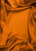 Hladké elegantní červené hedvábí lze použít jako pozadí — Stock fotografie