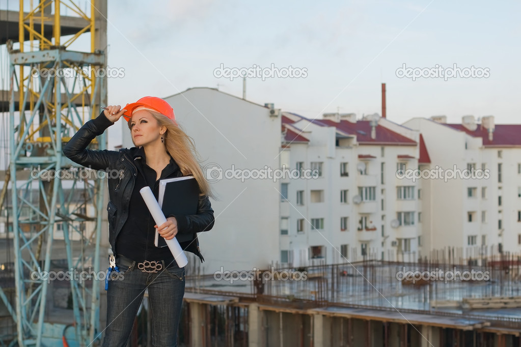 Series. The young girl in a helmet before building — Stock Photo #3997376