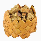 Rusks in small birch-bark box — Stock Photo