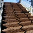 Stock Photo: Rusty Stairway in Elevated Walkway