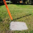 Stock Photo: Buried Fiber Optic Cable Warning Marker and Access Panel