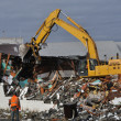 Stock Photo: Loader Demolishing Brick Building