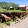 Stock Photo: Display of Mormon Settler Hand Carts at Heritage Park in Utah