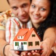 Happy couple with miniature house — Stock Photo #4073159
