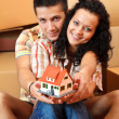 Royalty-Free Stock Photo: Happy couple with miniature house