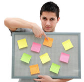 Young man showing onto the reminder board — Stock Photo