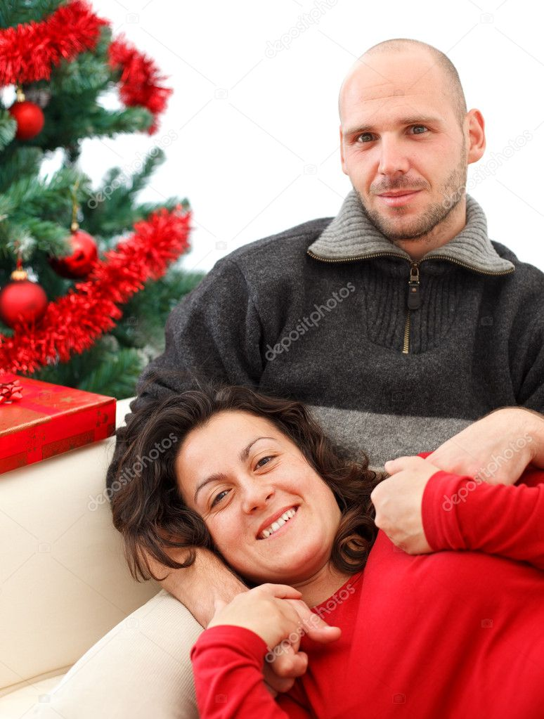 Young happy couple near a Christmas tree — Stock Photo #4289886