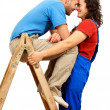 Stock Photo: Happy couple on the ladder