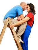 Happy couple on the ladder — Stock Photo