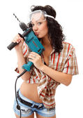 A young girl with drilling machine — Stock Photo