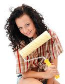 Sexy craftswoman met een rolborstel — Stockfoto