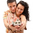 Happy couple with miniature house — Stock Photo #5129592