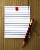 Lined paper and pencil  — Stock Photo