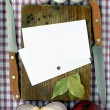 Paper for the recipes on a wooden board — Stock Photo #4742337
