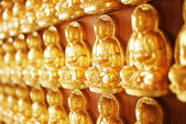 Many of Golden Buddha Statue on wooden wall in Chinese Temple — Stock Photo