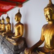 Row of Golden Buddha statue in Thailand Buddha Temple - Stok fotoğraf