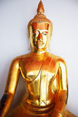 Golden Buddha Statue on white background — Stock Photo