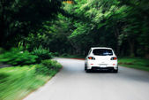 Speed drive following white car on the road — Stock Photo