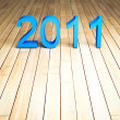 Stock Photo: 3d new year 2011 on wood background