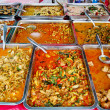 Variety of thai food in market - Stock Photo