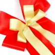 Stock Photo: Red and gold ribbon bow isolated