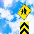 School warning traffic road sign on beautiful sky — Stock Photo